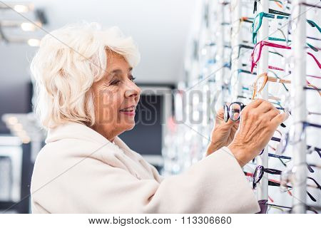 Opticians Patient Trying On Frames