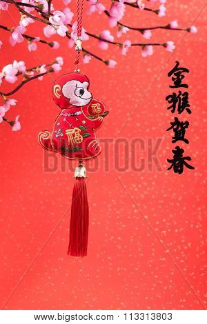 Chinese lunar new year ornaments on festive background.Chinese calligraphy translation: good bless for year of the monkey,