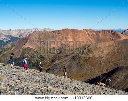 Hikers in alpine mountain terrain