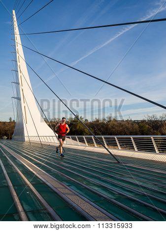 Solo runner crosses the Sundial Bridge