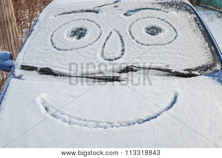 Snow-covered Car With Smiley