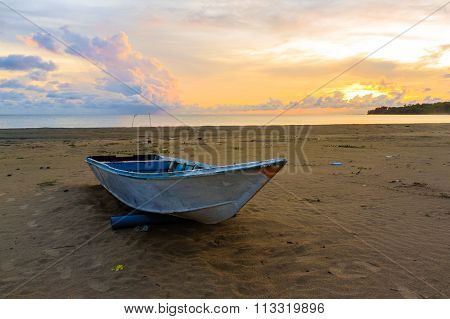 The Fisherman Boat with beautiful sunrise at Manikar beach, Labuan, Malaysia.