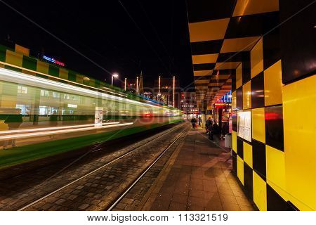 HANOVER, GERMANY - DECEMBER 03, 2015: artistic tram shelter at Steintor in Hanover with unidentified people. It is a city art project with 10 shelters. This one was designed by Alessandro Mendini