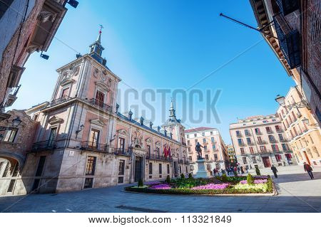 MADRID, SPAIN - MARCH 16, 2015: Plaza de La Villa with unidentified people in the old town of Madrid is probably the oldest civil square dating back to 15th century.