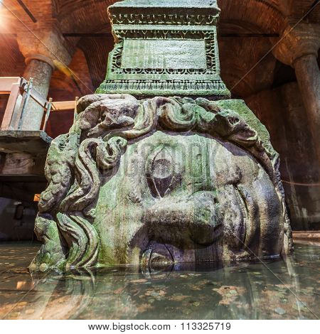 ISTANBUL, TURKEY - APRIL 11, 2015: Medusa sculpture in the Basilica Cistern, that is the largest of several hundred ancient cisterns in the city, built in the 6th century during the reign of Justinian