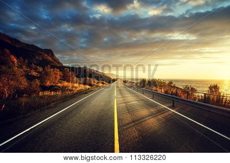 road by the sea in sunrise time,  Lofoten island, Norway