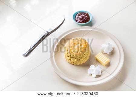 Simple English Scones Set With Butter, Cream And Strawberry Jam