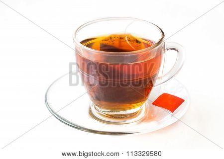 Hot Tea With Tea Bag In Transparent Cup And Saucer