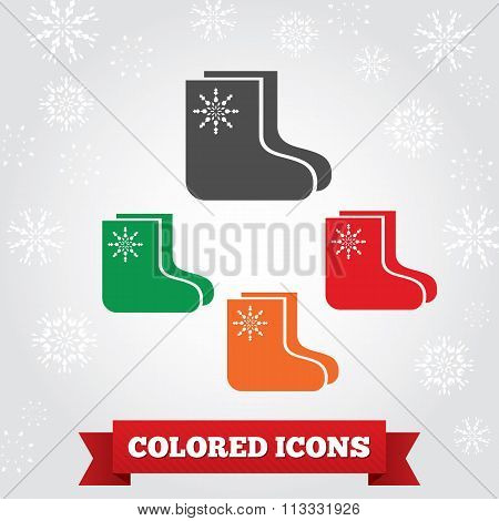 Socks, felt boots icon. Christmas, holiday, winter symbol. Colored signs on light gray background wi