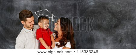 Happy young couple who are standing with their son at graduation