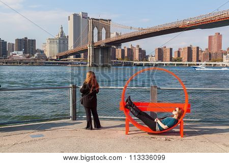 NEW YORK CITY - OCTOBER 08, 2015: view from Brooklyn over East River with unidentified people. The metropolitan area NYC is one of the most important economy areas and commercial center of the world