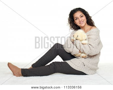 beautiful young woman sit on floor, white background