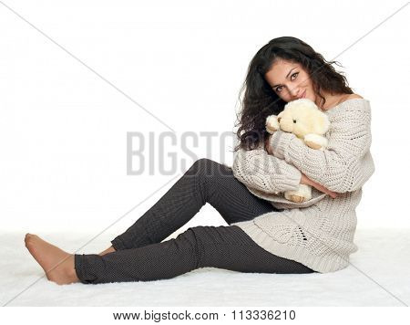 beautiful young girl sit on floor, white background