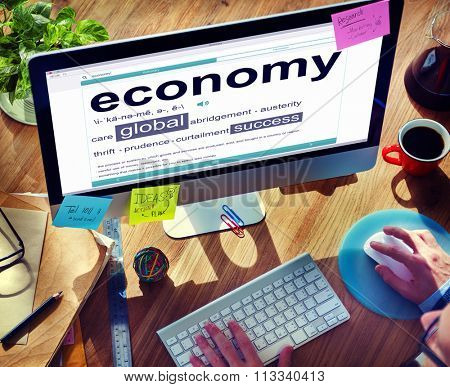Man Reading the Definition of Economy