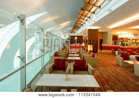 DUBAI, UAE - NOVEMBER 16, 2015: interior of Emirates business class lounge. Emirates is the largest airline in the Middle East. It is an airline based in Dubai, United Arab Emirates.