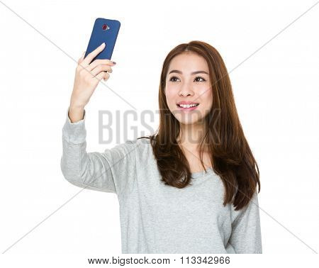 Asian woman take selfie by mobile phone