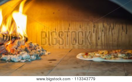 Abstract blur pizza in oven