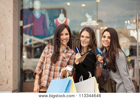 Girls Spending Money At A Shopping Mall