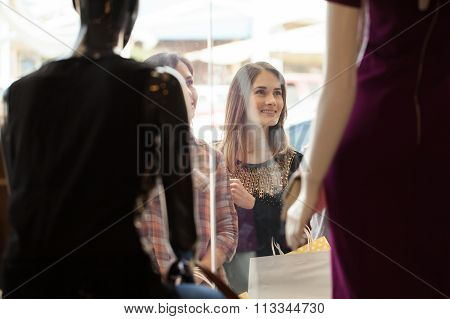 Girls Looking At A Clothing Store Display