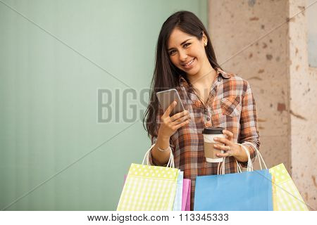 Woman Using Her Mobile Phone At The Shopping Mall