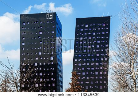 MILAN, ITALY - FEBRUARY 23: NH Hoteles Rho on February 23, 2014 in Milan. The hotel built in 2009 with two inclined towers is from architect Dominique Perrault.