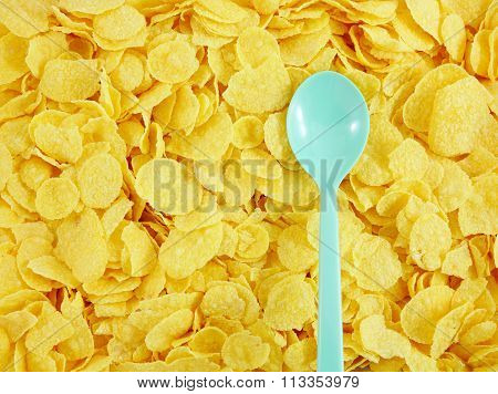 The tasty golden corn flakes and plastic spoon