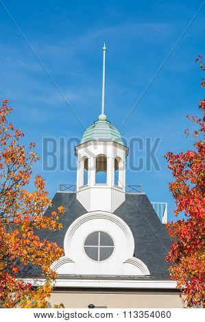 Steeple And Trees With Autumn Leaves