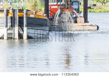 Dredging In The Harbor Basin