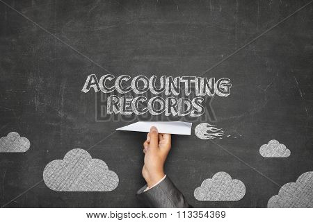 Accounting records concept on blackboard with paper plane