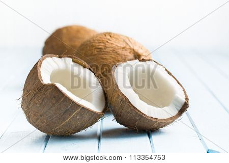 halved coconut on kitchen table