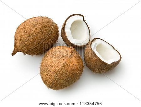 halved coconut on white background