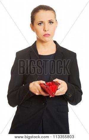 Poor upset businessswoman holding empty wallet