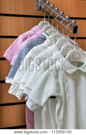 Collection Of Baby Jumpsuits On Hangers