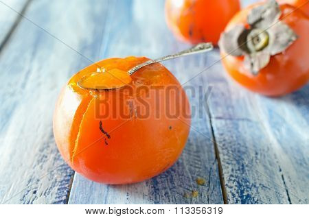 Ripe Sweet Persimmons On Wooden Table