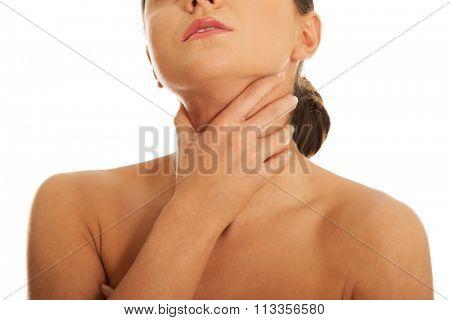 Young woman having huge throat pain