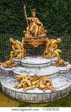 Versailles, France - August 05, 2014: fountain -the triumphant France- - in the gardens of Versailles. Palace of Versailles with gardens is one of the largest palace complexes in Europe, protected by UNESCO