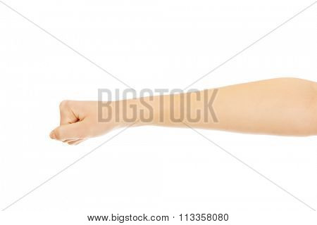 Woman hand with clenched a fist.
