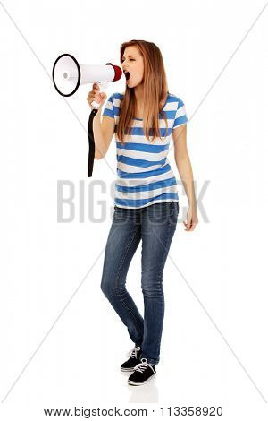 Teenage woman screaming through megaphone.