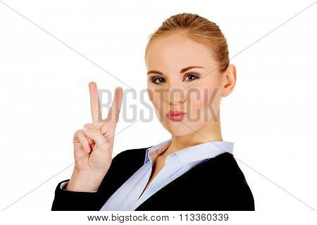 Happy business woman showing victory sign.