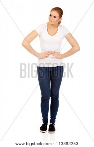 Young woman with stomach ache.