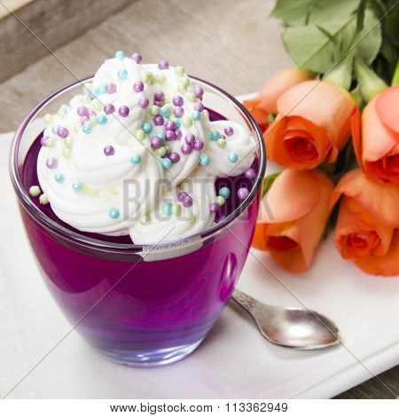 Colorful jelly with whipped cream