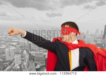 Businessman superhero in a red cloak. Business concept.