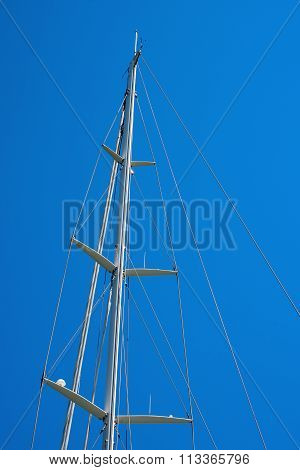 Mast Of Sailboat Against A Blue Sky