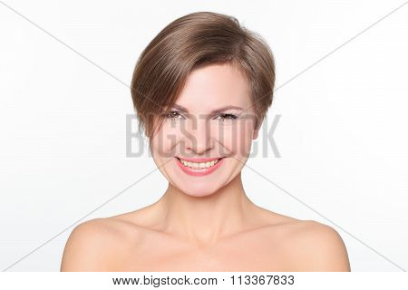 portrait of a beautiful woman with bare shoulders and short hair. wryly.