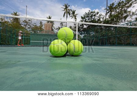 Tennis balls on the court close-up