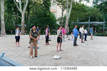 NEW YORK - SEPTEMBER 06: People practicing Falun Gong in NYC. Falun Gong or Falun Dafa is a Chinese spiritual practice that combines meditation and qigong exercises. September 06, 2015 in New York.