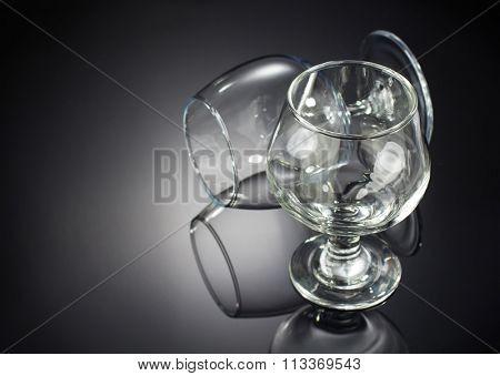 cognac glass on black background