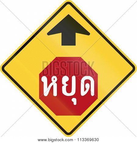 Warning Road Sign In Thailand - Stop Sign Ahead. The Text Means Stop