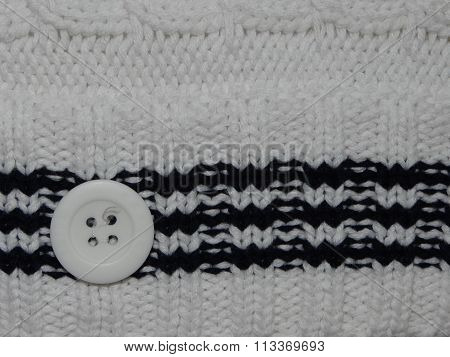 large white knit with button