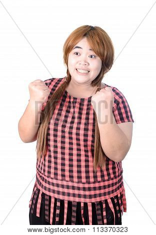 Successful Plump Woman Punching The Air With Her Fists In Air, Smiling And Shouting, Isolated On Whi